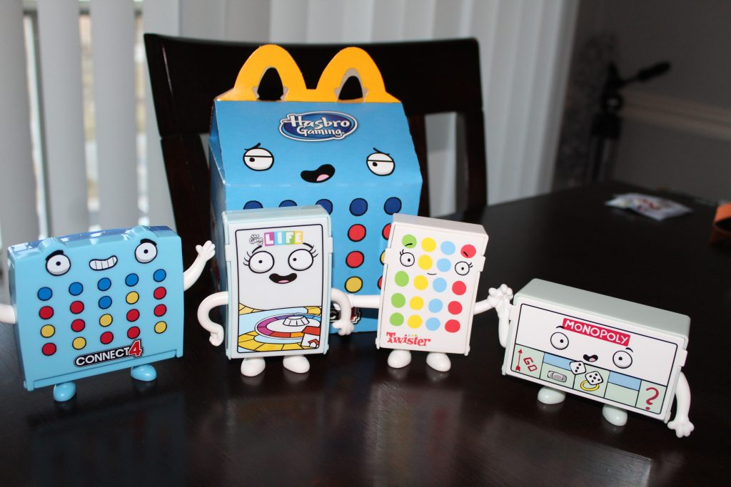 January 2021 Hasbro Gaming McDonald's Happy Meal Toys featuring mini Monopoly, Connect 4, Life, and Twister