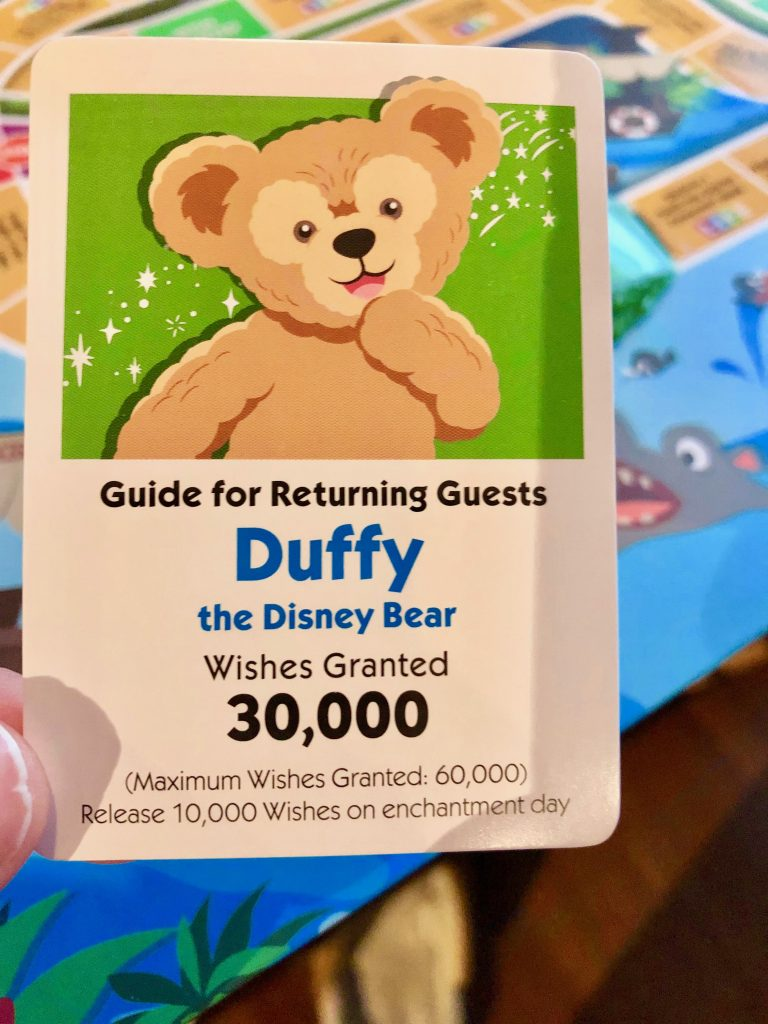 The Game of Life Disney Theme Parks Edition Park Guide Card with Duffy the Disney Bear
